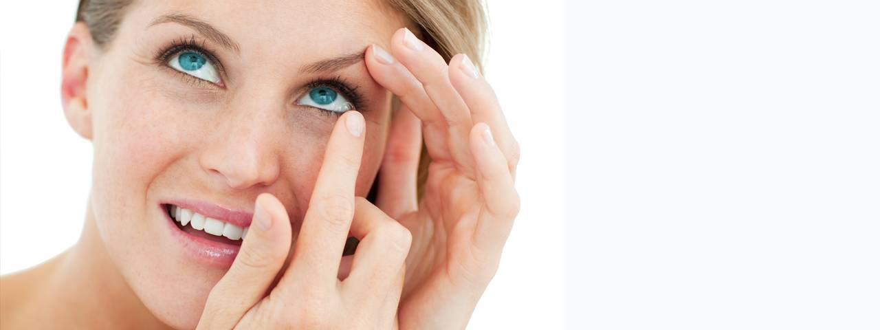attractive blond putting in contact lens in North Miami Beach, FL
