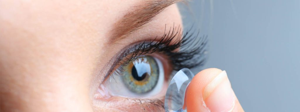 Woman inserting contact lens, optometrist, Allentown, Whitehall, PA